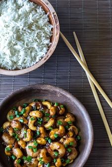 Portion of cashew shrimp stir-fry with rice