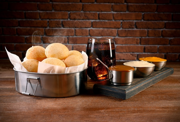 Portion of cheese bread - traditional brazilian food with cheddar, curd and dulce de leche