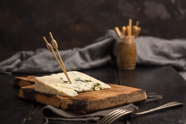Portion of cheese roquefort at a table rustic.