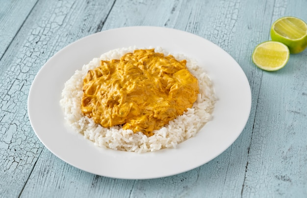 Portion of chicken curry garnished with rice