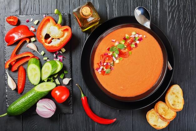 Portion of delicious gazpacho in black bowl