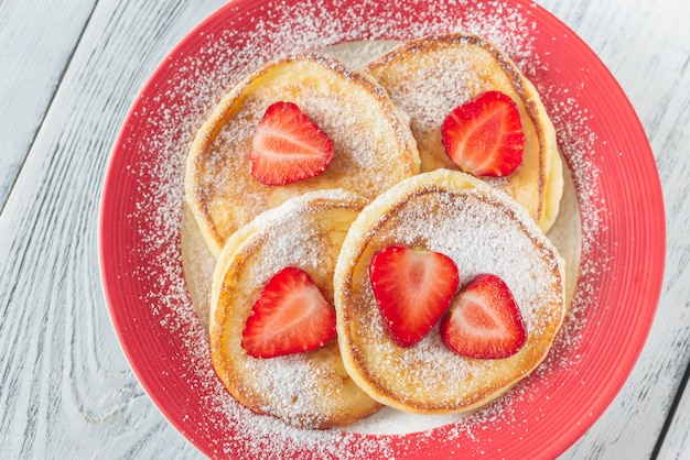 Portion of ricotta fritters with fresh strawberries