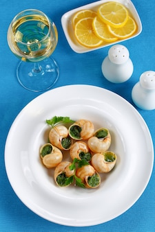 Portion of snails with herbs and butter