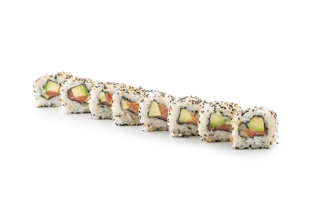 Portion of sushi uramaki isolated on white background.