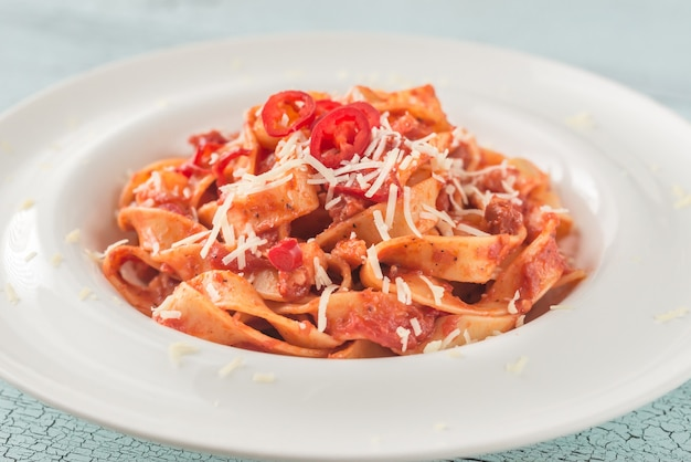 Portion of tagliatelle pasta with amatriciana sauce
