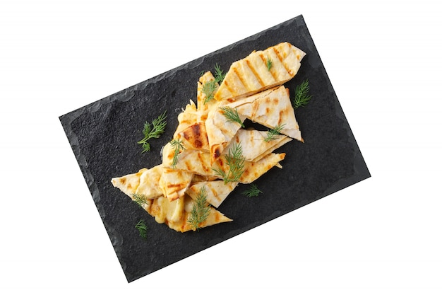 Portion of thin pita stuffed with melted cheese isolated