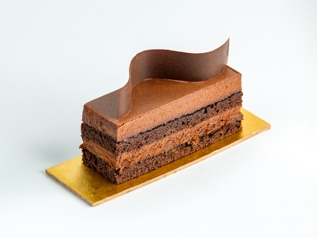 Portioned chocolate cake garnished with thin chocolate wave