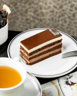 Portioned chocolate cake served with tea