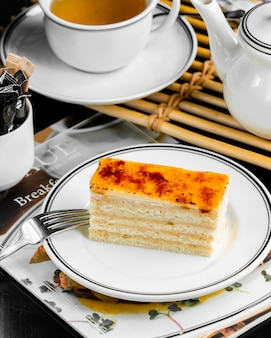 Portioned french pastry creme brulee cake layered with cream