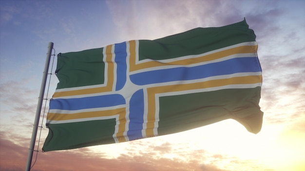 Portland city flag, city of usa waving in the wind, sky and sun background. 3d rendering