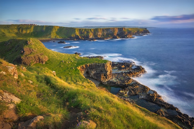 Portnaboe bay and north antrim cliff from great stookan, giant's causeway, uk