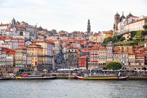 Porto, the ribeira district, portugal old town ribeira view with colorful houses, traditional facades, old multi-colored houses with red roof tiles