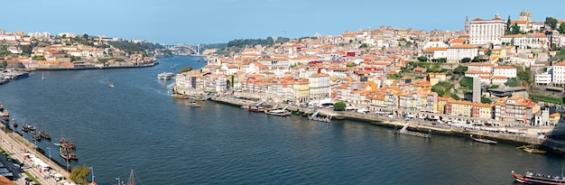 Porto view of douro river, boats and old buildings on sunny day. porto panoramic cityscape