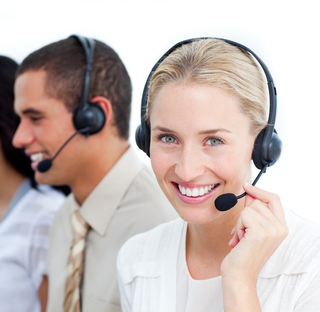 Portraif of a businesswoman and her team working in a call cente