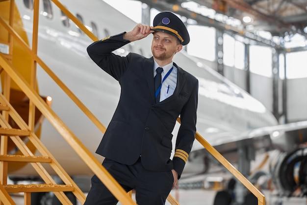 Portrair of plane crew in hangar of technical service