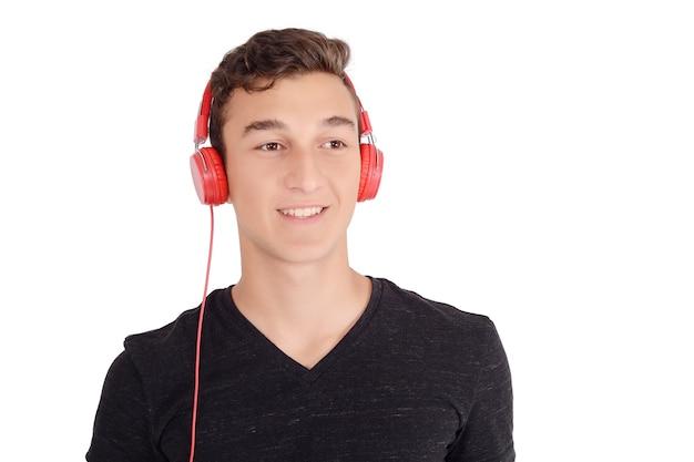 Portrair of smiling teen listening music with headphones