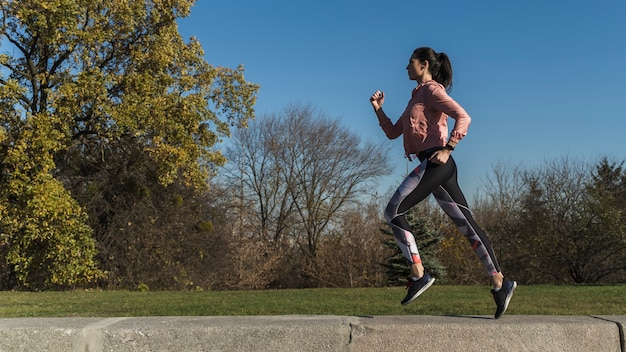Portrait of active woman running outdoor