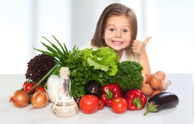 Portrait of adorable little girl preparing healthy food at kitchen