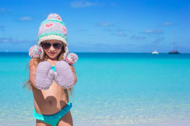 Portrait of adorable little girl on summer vacation at white beach