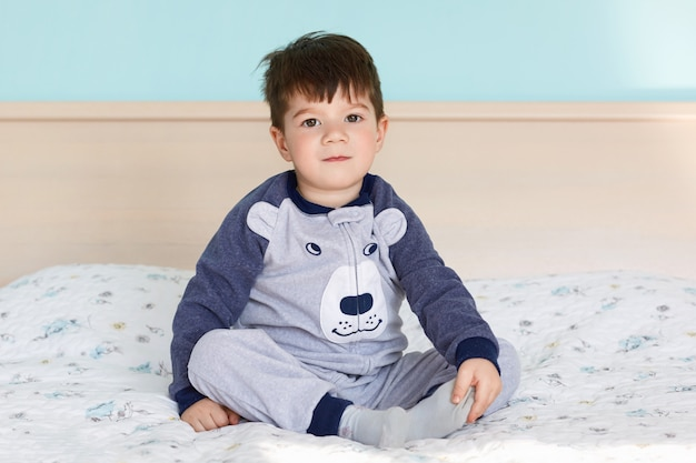 Portrait of adorable small kid in pyjamas