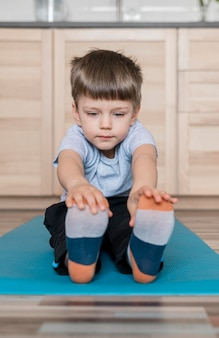 Portrait of adorable young boy stretching