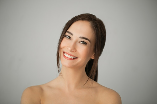 Portrait of adult brunette woman with perfect skin. skin care concept