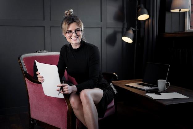 Portrait of adult businesswoman smiling