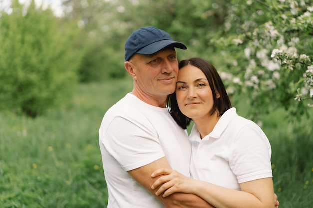 Portrait of an adult couple in love in the garden.