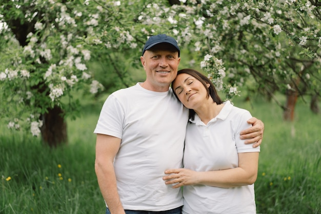 Portrait of an adult couple in love in the spring garden.