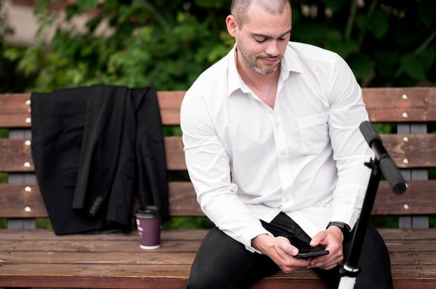 Portrait of adult male browsing mobile phone