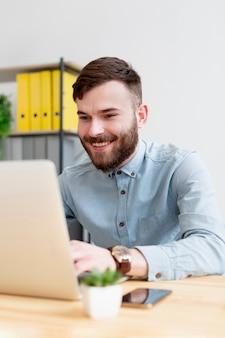 Portrait of adult male enjoying work