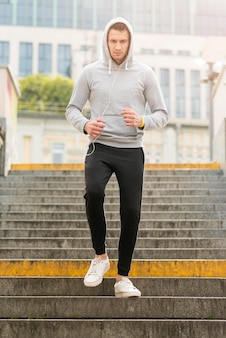 Portrait of adult male exercising outdoors
