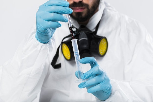 Portrait of adult male taking medical samples