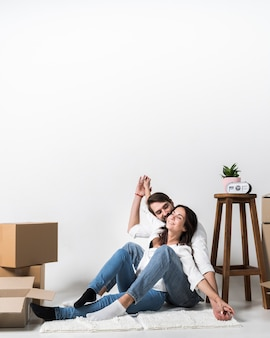 Portrait of adult man and woman together at home