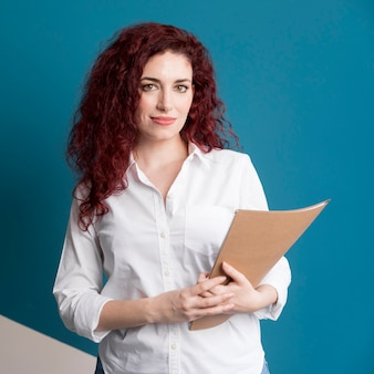 Portrait of adult woman holding documents
