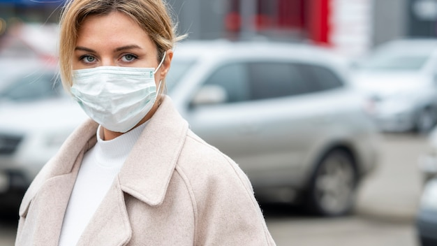 Portrait of adult woman wearing surgical mask