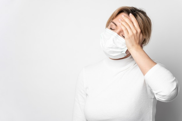 Portrait of adult woman with illness symptom