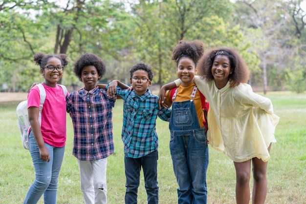 Portrait of african american childrens standing and looking in the park
