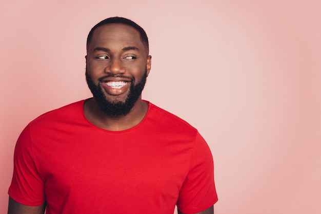 Portrait of african american male isolated over pink background