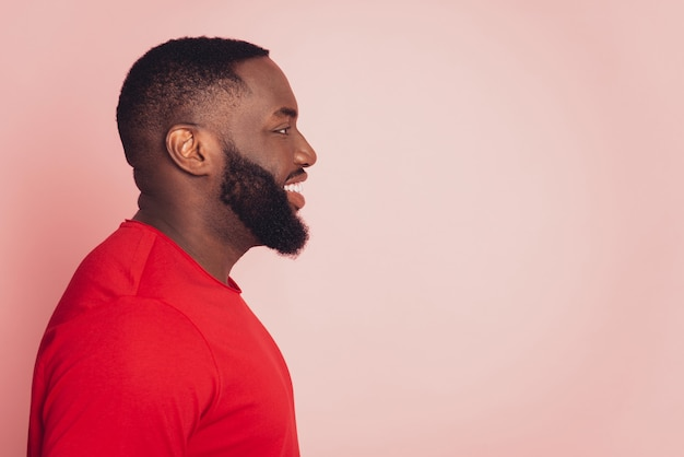 Portrait of african american male look empty space isolated over pink background