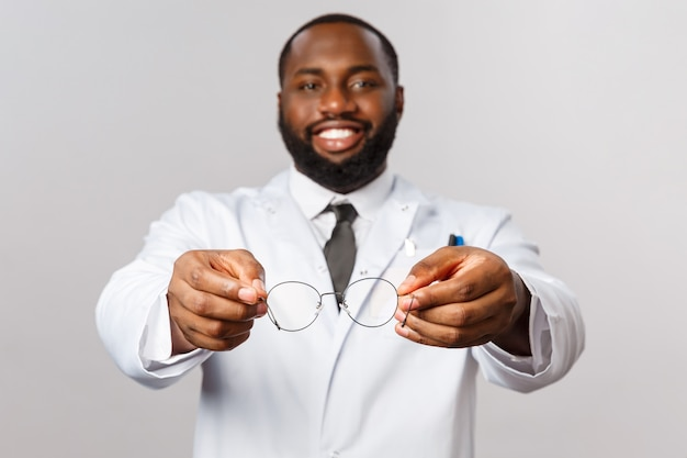 Portrait of african american physician or doctor in white uniform.