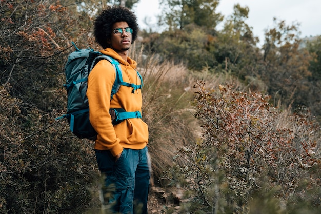 Portrait of an african male hiker hiking in the forest