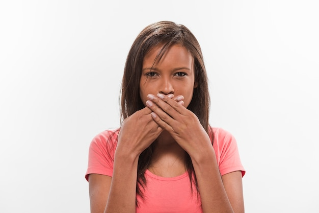 Portrait of an african teenage girl covering her mouth