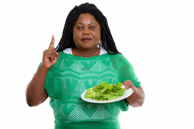 Portrait of african woman holding salad