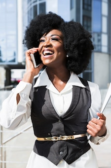 Portrait of an african young businesswoman talking on mobile phone