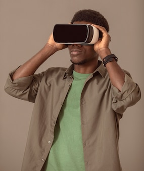 Portrait of afro-american man using virtual reality headset