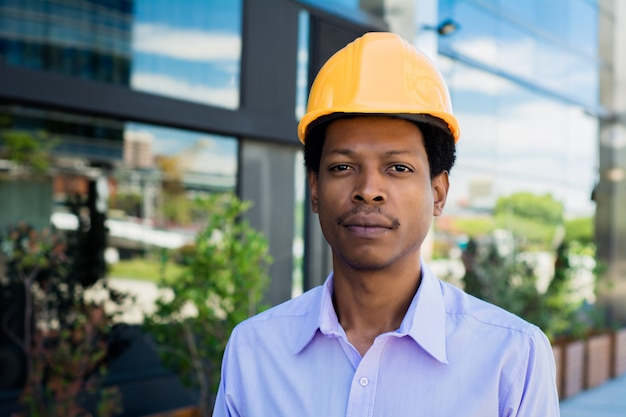 Portrait of afro man architect in hard hat
