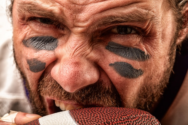 Portrait of an aggressive american football player