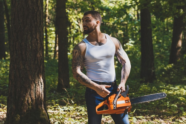 Portrait of aggressive muscular male lumberjack