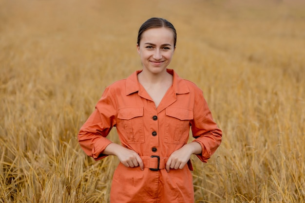 Portrait agronomist farmer with digital tablet computer in wheat field.